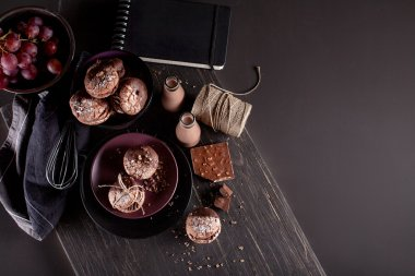Organic almond cookies, grapes on dark wooden background with ch