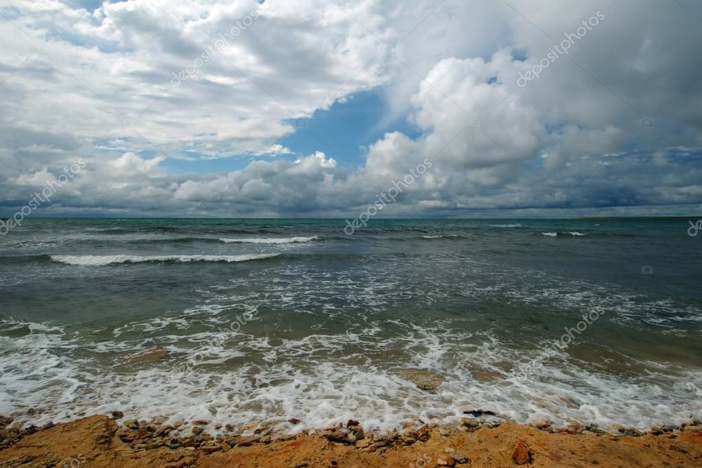 Sea surf and clouds