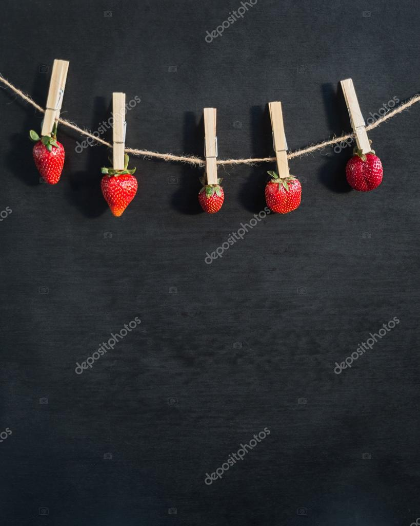 berries on a wooden clothespins
