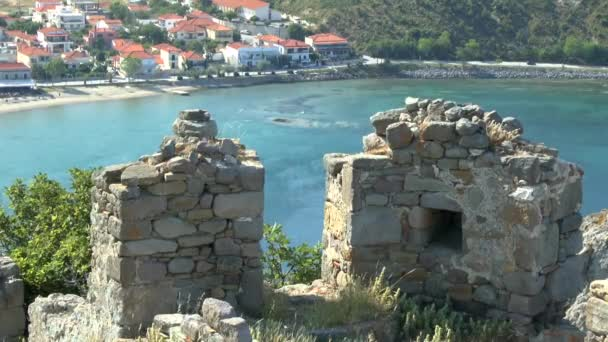 Ruins of an ancient wall on the background of the bay.