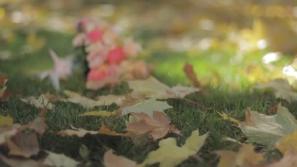 Wedding bouquet lying on the grass in autumn