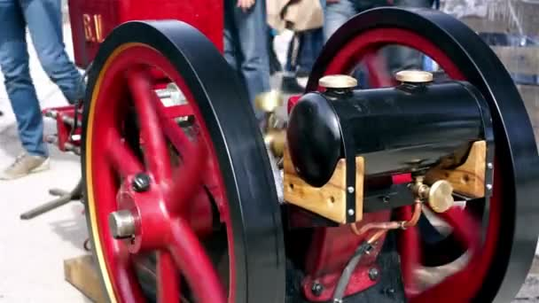 mechanical engineer starting an old diesel engine at exhibition closeup view stock video
