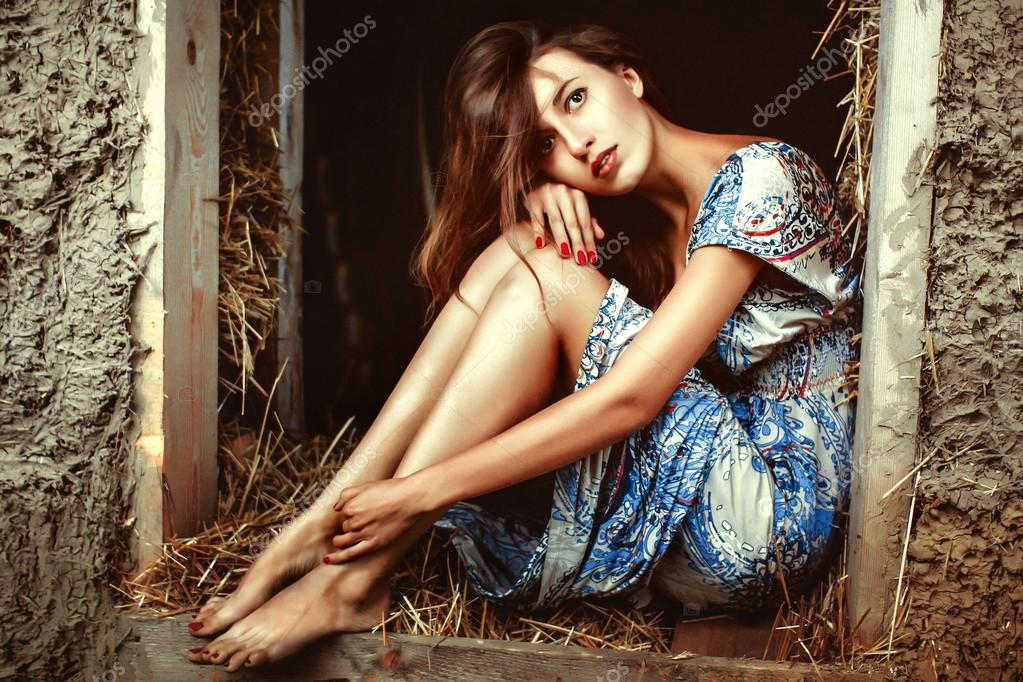 girl in the hay in a dress