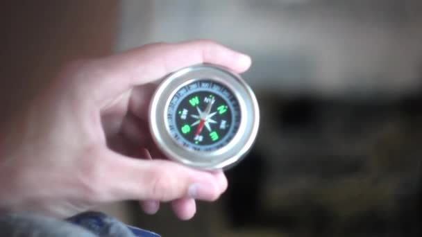 holding the compass