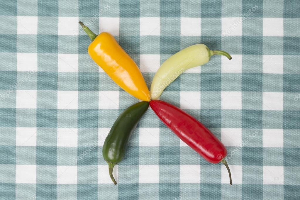 Chili Peppers In Different Colors On Tablecloth. Top Down Viewpoint. U2014  Photo By Zoff Photo
