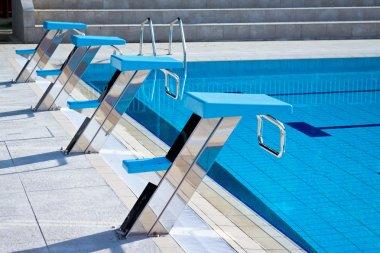 Swimming pool starting blocks in a row
