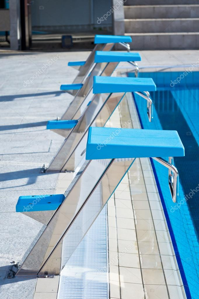 Swimming pool starting blocks in a row — Stock Photo © Zoff ...