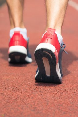 Close up of running shoes in use on the running track