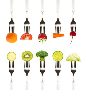 fruits and vegetables on the collection of forks