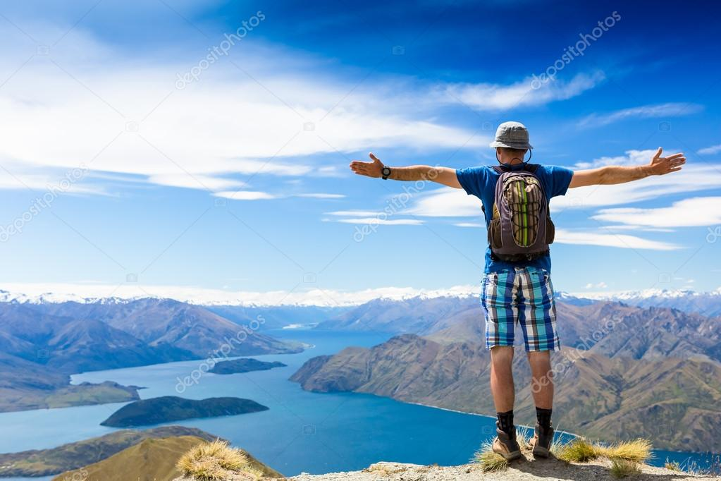 hiker at the top of mountain