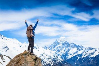 Successful hiking man on mountain
