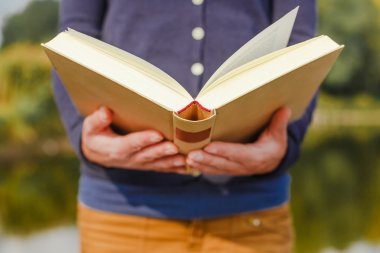 female hands holding open book
