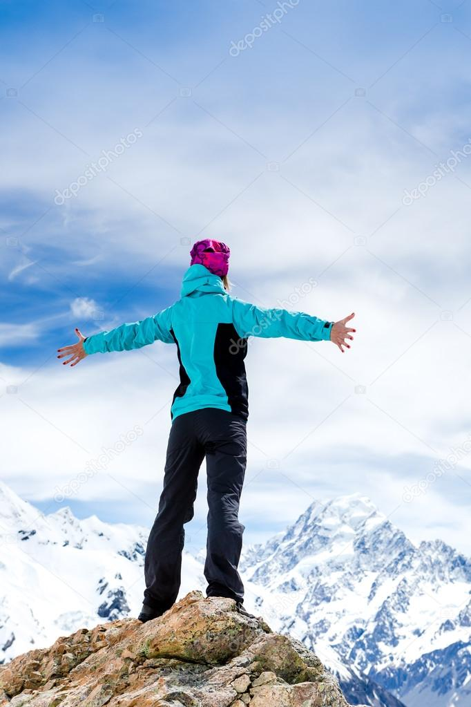 Woman hiker at the top of a rock