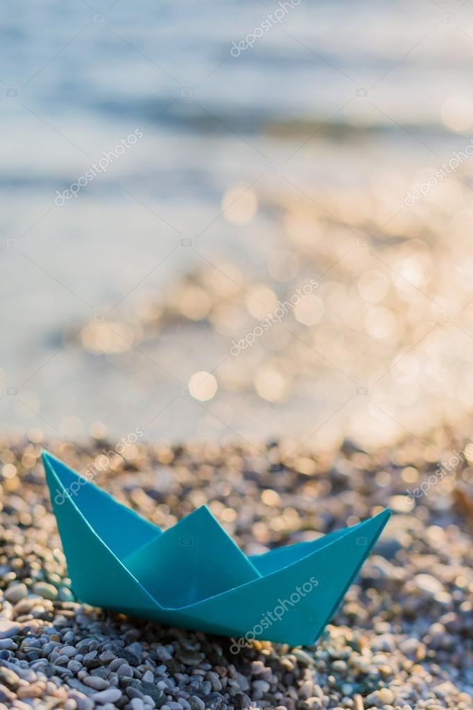 paper boat on beach