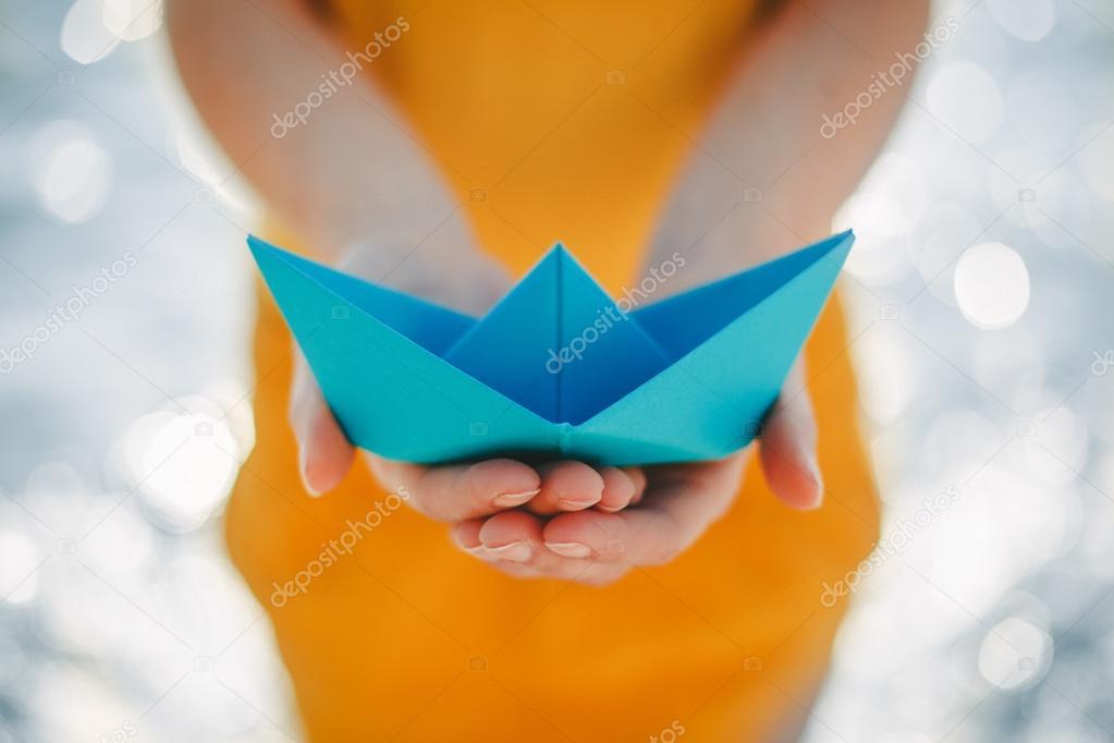 paper boat in hands