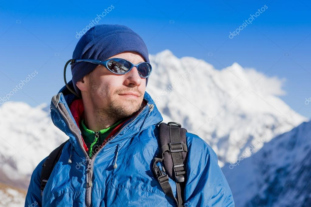 man with a backpack in Himalayas