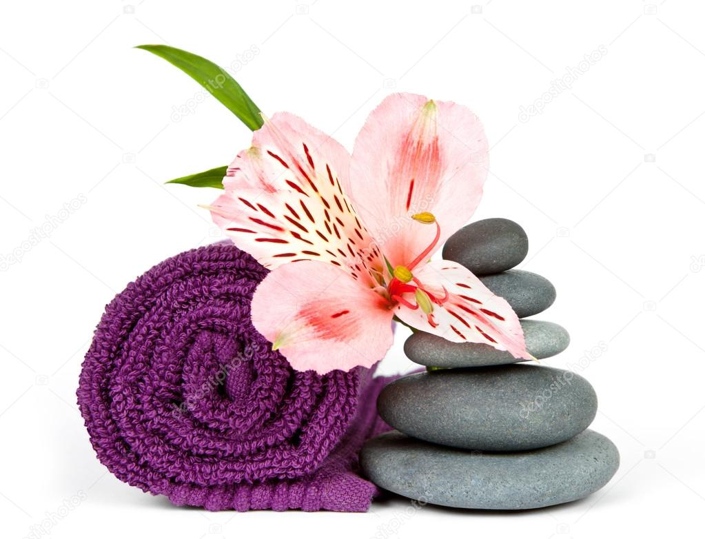 Pebbles flowers and towel stock photo olyphotostories 119165460 pebbles flowers and towel stock photo izmirmasajfo