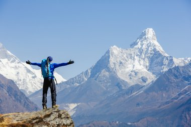 Hiker enjoying the view on the Everest trek in Himalayas, Ama Dablam mountain view, Nepal