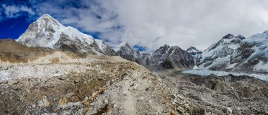 panoramic view of Mount Pumori and Everest with beautiful sky - way to Everest base camp, Khumbu valley, Sagarmatha national park, Nepal
