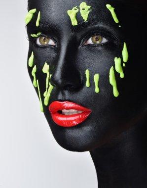 beautiful woman face with professional makeup