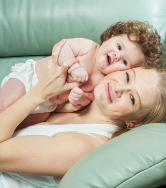 Mother and baby playing and smiling