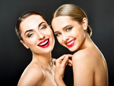 Studio portrait of two young beautiful women