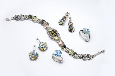 Jewelry set of silver rings, earrings and blacelet with topazes