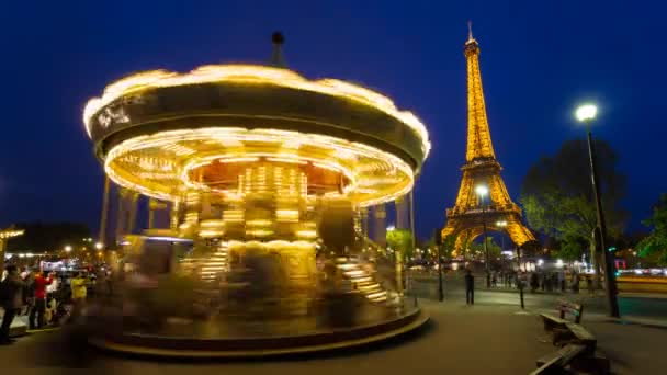 Carousel below the Eiffel Tower at twilight