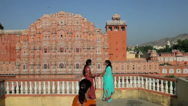 women in colourful saris