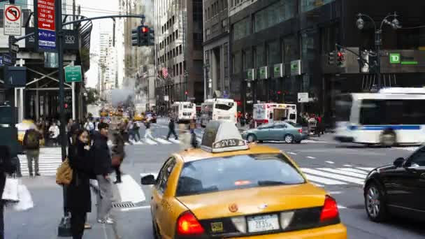 Taxis and street scene at intersection, New York