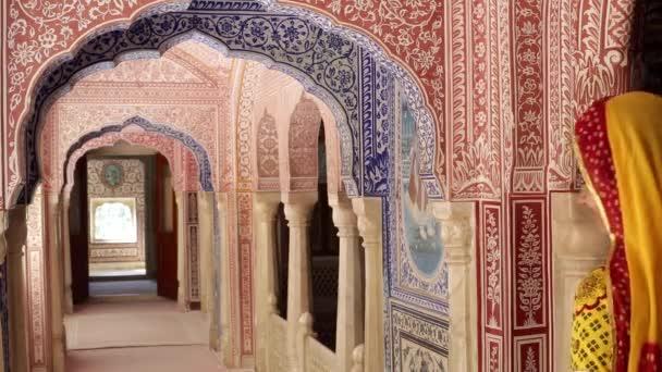 lady wearing  Sari in ornate passageway