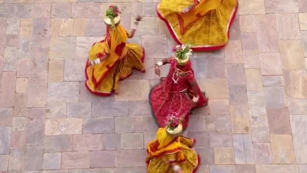 women wearing Saris dancing outdoors
