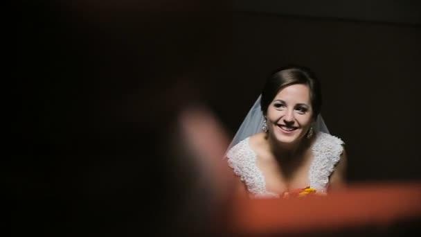 Bride in a dark room