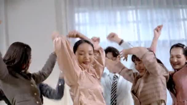 portrait group of asian business people dancing feeling happy and relaxing funny at indoor office. Concept people self confident and proud themselves.