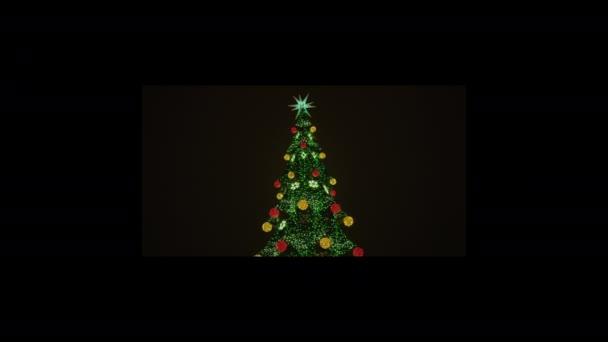 Vánoční stromek s barevnými kuličkami, elektrickými věnci, jiskřícími a blikajícími.