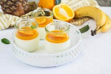 Vanilla panna cotta with fruits sauce