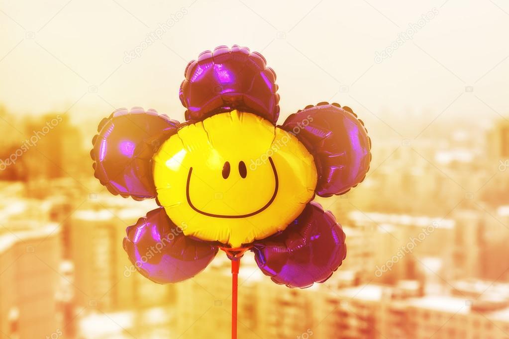 Air balloon with smiley face
