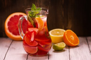 Jar of traditional red spanish sangria drink with different citrus