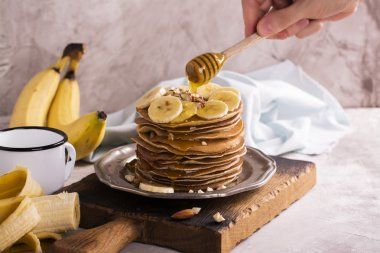 Pile of pancakes with ingredients