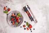 Fotografie Infused water in glass bottle and fresh berries