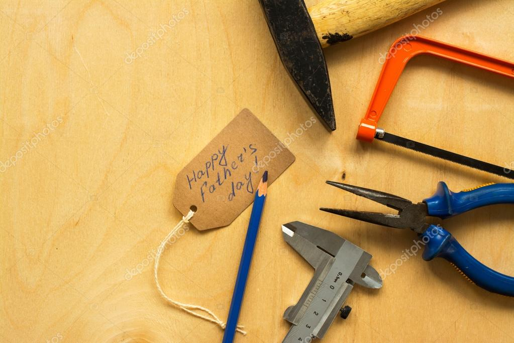 Different tools over plywood background