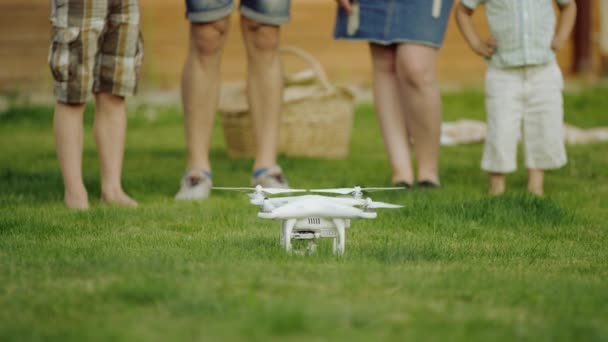 family watches quadrocopter drone flight