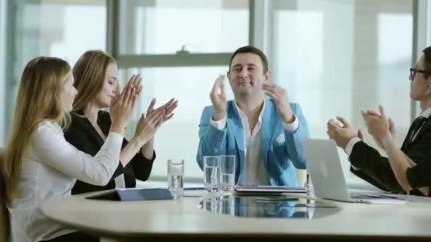 businessmen rejoice success and applaud
