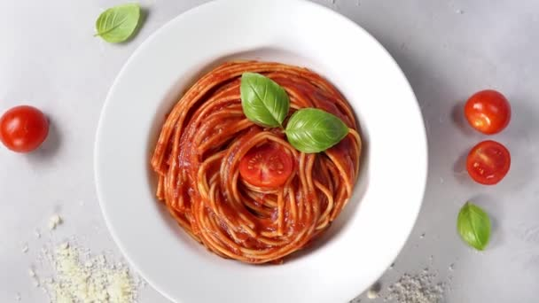 Spaghetti with tomato sauce in plate top view. 360 degree rotation. Pasta background. Close up. 4K UHD
