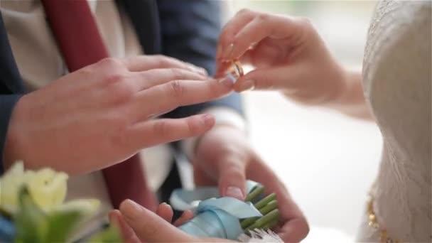 Groom and bride exchange wedding rings Stock Video SpstudioVideo