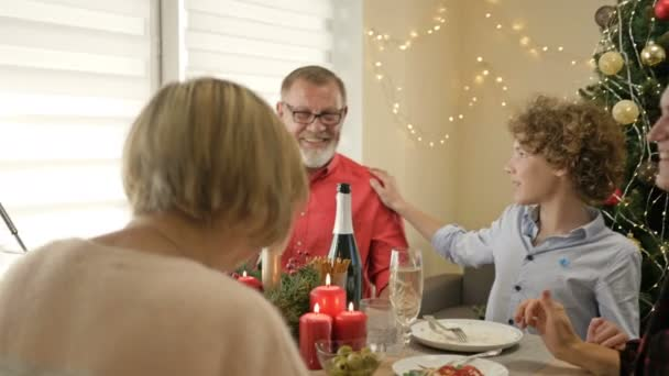 Cheerful conversation at the festive table. Family celebrating Christmas together. Traditional festive christmas dinner.