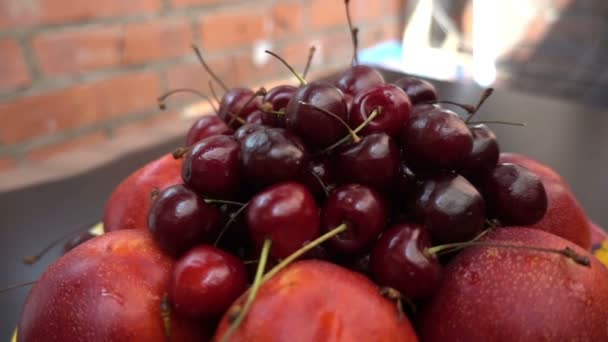 close view of different fresh fruits, nectarines and cherries