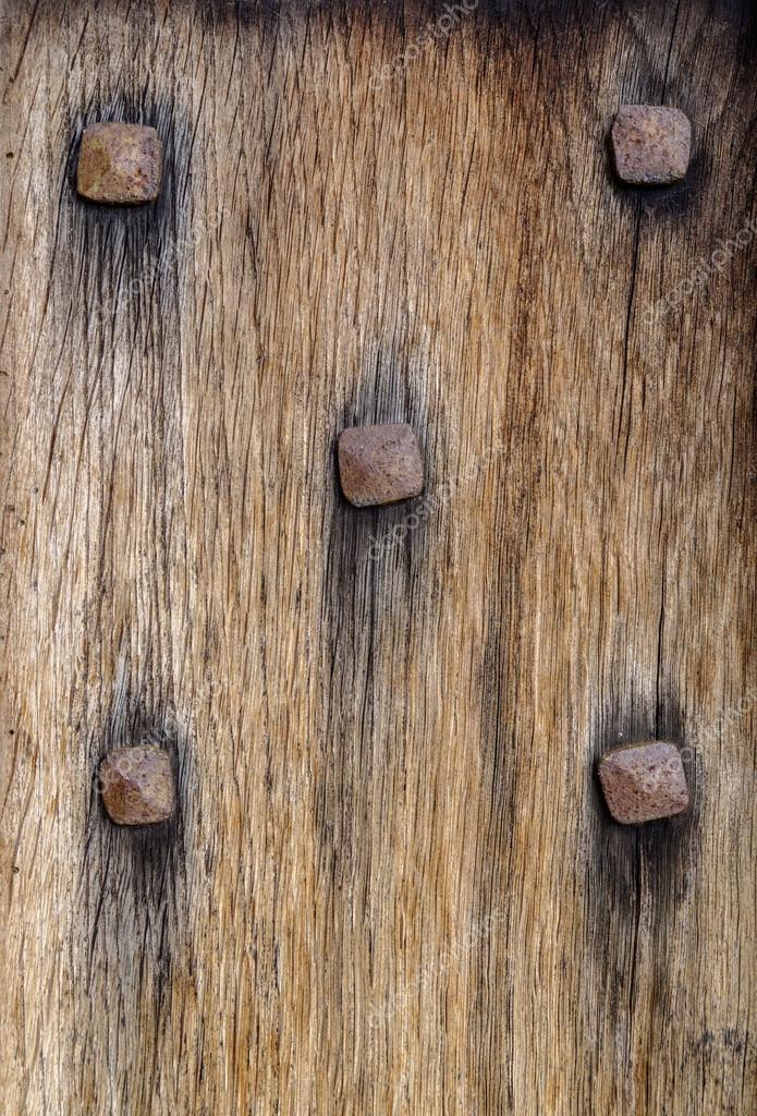 Vieja puerta de madera con clavos oxidados como domino - Clavos para madera ...