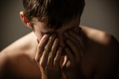 Shirtless Teenage Boy Hiding Face in Hands