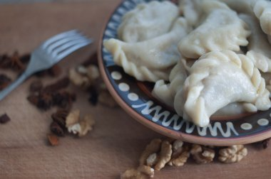 Vareniki (dumplings), pierogi after boiling - traditional Ukrainian food
